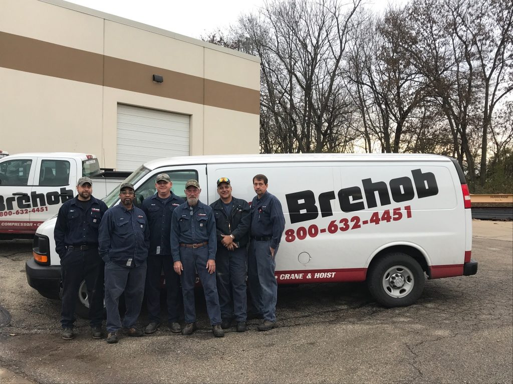 Cincinnati service techs standing in front of Brehob van